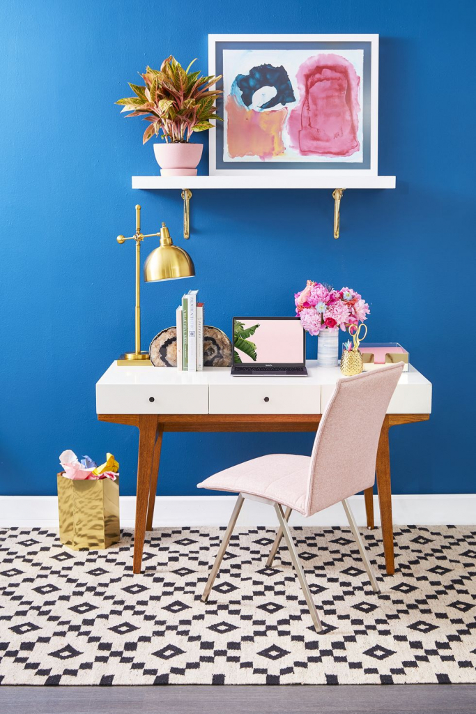 Home office with a blue painted wall