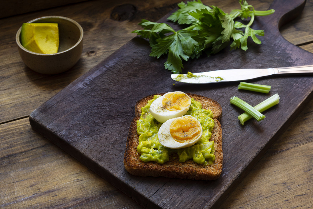 Healthy breakfast idea Toasted bread with avocado and egg